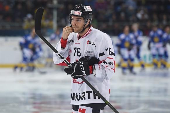 epa05689612 Canadas Marc-Antoine Puiliot during the game between Switzerlands HC Davos and Team Canada at the 90th Spengler Cup ice hockey tournament in Davos, Switzerland, 27 December 2016.  EPA/MELANIE DUCHENE