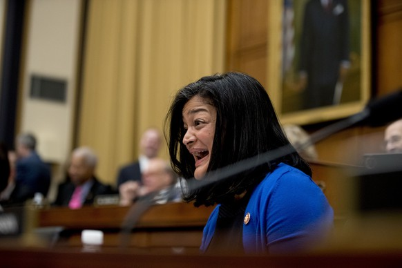 Rep. Pramila Jayapal, D-Wash, reacts as Acting Attorney General Matthew Whitaker tells Judiciary Committee Chairman Jerrold Nadler, D-N.Y., that his time has expired as he appears before the House Judiciary Committee on Capitol Hill, Friday, Feb. 8, 2019, in Washington. Democrats are eager to press him on his interactions with President Donald Trump and his oversight of the special counsel's Russia investigation. (AP Photo/Andrew Harnik)