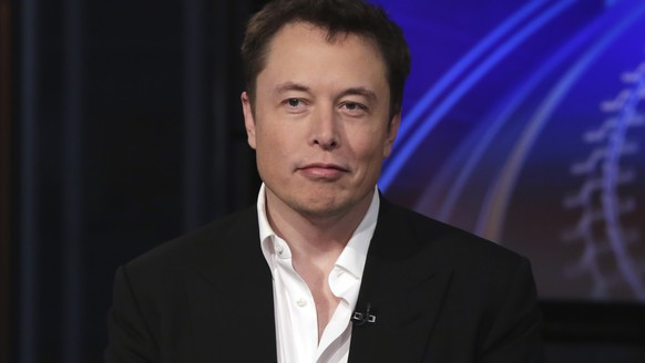 FILE - In this Wednesday, Sept. 17, 2014 file photo SpaceX billionaire founder and chief executive, and Tesla Motors CEO Elon Musk, is interviewed in New York. The billionaire's Boring Company tweeted Wednesday, Aug. 15, 2018, a proposal for autonomous, zero-emissions electric sleds that would run through a tunnel between the Dodger Stadium and a location in the city's Hollywood area. A proposal to build a gondola from Union Station to Dodger Stadium was announced in April. (AP Photo/Richard Drew, File)