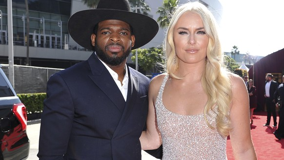 "FILE - In this July 10, 2019 file photo, P.K. Subban, left, of the New Jersey Devils, and Lindsey Vonn arrive at the ESPY Awards at Microsoft Theater in Los Angeles. Vonn popped the question to hockey star Subban. ""Merry Christmas and happy holidays everyone!! On our 2 year anniversary, in a ""non traditional"" move, I asked PK to marry me and he said, Yes,"