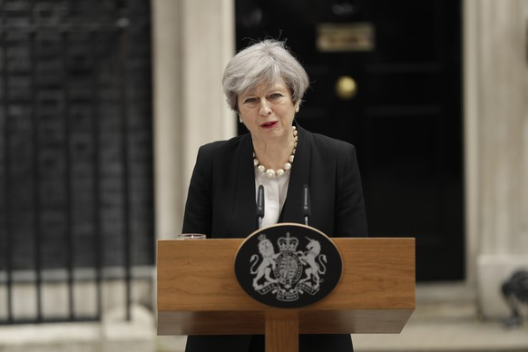 British Prime Minister Theresa May addresses the media outside 10 Downing Street, London, Tuesday May 23, 2017, the day after an apparent suicide bomber attacked an Ariana Grande concert as it ended Monday night, killing over a dozen of people among a panicked crowd of young concertgoers. (AP Photo/Matt Dunham)