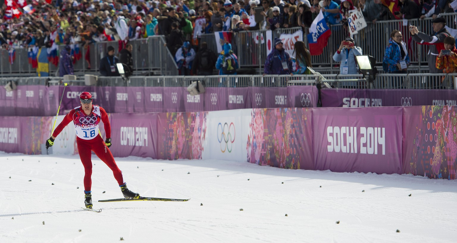 Dario Cologna of Switzerland in action during the men's cross country mass start 50km competition at the XXII Winter Olympics 2014 Sochi in Krasnaya Polyana, Russia, on Sunday, February 23, 2014. (KEYSTONE/Jean-Christophe Bott)