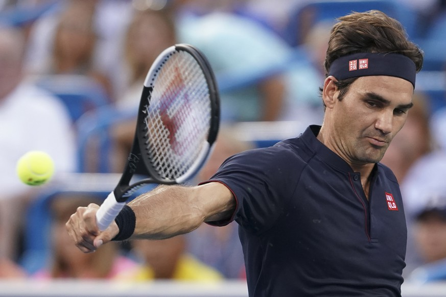Roger Federer, of Switzerland, returns to David Goffin, of Belgium, during the semifinals at the Western & Southern Open tennis tournament, Saturday, Aug. 18, 2018, in Mason, Ohio. (AP Photo/John Minchillo)