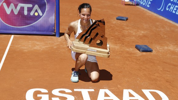 Viktorija Golubic of Switzerland celebrates with the trophy after winning the final match against Kiki Bertens of the Netherlands, at the WTA Ladies Championship tennis tournament in Gstaad, Switzerland, sunday, July 17, 2016. (KEYSTONE/Peter Klaunzer)