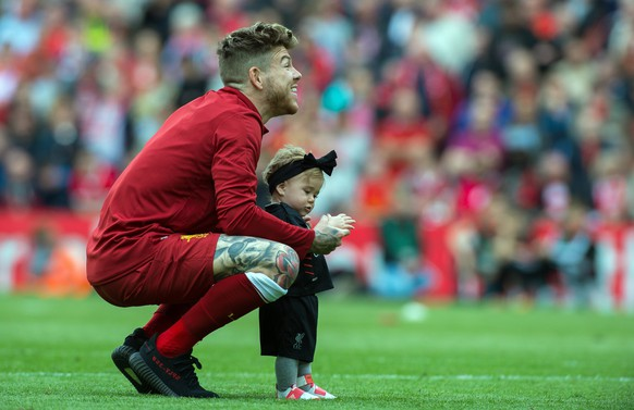 epa05979479 Liverpool's Alberto Moreno reacts with the crowd during a walk around the pitch after the English Premier League soccer match between Liverpool and Middlesbrough held at the Anfield in Liverpool, Britain, 21 May 2017.  EPA/PETER POWELL EDITORIAL USE ONLY. No use with unauthorized audio, video, data, fixture lists, club/league logos or 'live' services. Online in-match use limited to 75 images, no video emulation. No use in betting, games or single club/league/player publications EPA/PETER