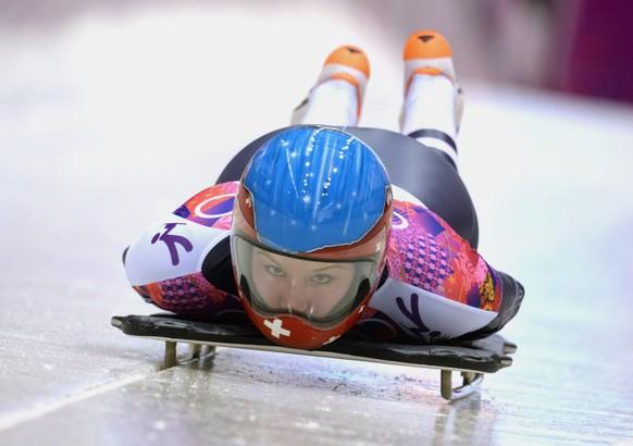 epa04073333 Marina Gilardoni of Switzerland at the start of Heat 1 in the women's Skeleton competition at the Sanki Sliding Center at the Sochi 2014 Olympic Games, Krasnaya Polyana, Russia, 13 February 2014.  EPA/VASSIL DONEV