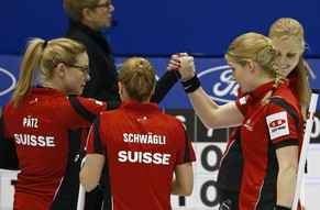 Switzerland's skip Alina Paetz, Nicole Schwaegli, Nadine Lehmann and Marisa Winkelhausen celebrate after beating Finland during their curling round robin game at the World Women's Curling Championships in Sapporo March 17, 2015.  REUTERS/Thomas Peter (JAPAN - Tags: SPORT CURLING)