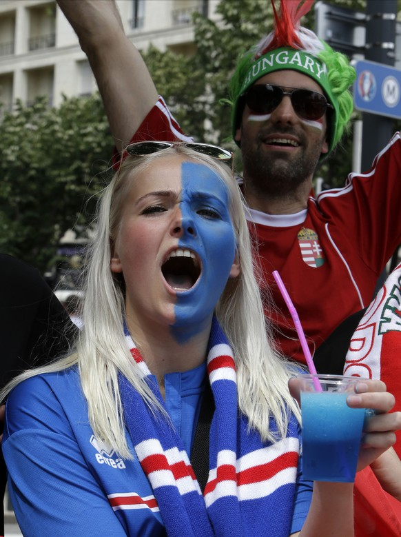 Iceland's and Hungary's fans cheer for their team before the Euro 2016 Group F soccer match between Iceland and Hungary at the Velodrome stadium in Marseille, France, Saturday, June 18, 2016. (AP Photo/Claude Paris)