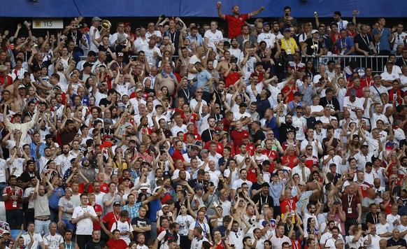 England fans celebrate during the quarterfinal match between Sweden and England at the 2018 soccer World Cup in the Samara Arena, in Samara, Russia, Saturday, July 7, 2018. (AP Photo/Francisco Seco)
