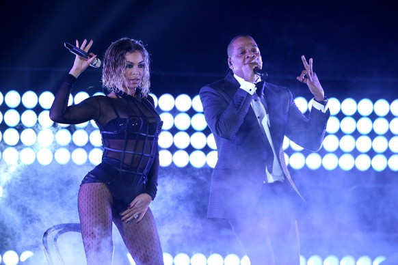 Beyonce, left, and Jay-Z perform