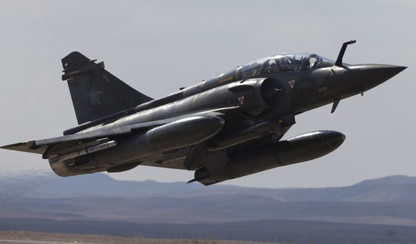 In this Wednesday, Nov. 8, 2017 photo, A French Mirage 2000D jet fighter takes off from Ovda airbase near Eilat, southern Israel, during the 2017 Blue Flag exercise. Israel's military is holding the largest ever air drill of its kind with pilots from eight countries simulating combat scenarios. It said Thursday that Germany, India and France are taking part for the first time in the two week drill codenamed