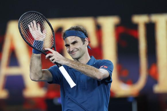 epa07295013 Roger Federer of Switzerland celebrates defeating Taylor Fritz of the USA during their round three men's singles match at the Australian Open Grand Slam tennis tournament in Melbourne, Australia, 18 January 2019.  EPA/LYNN BO BO