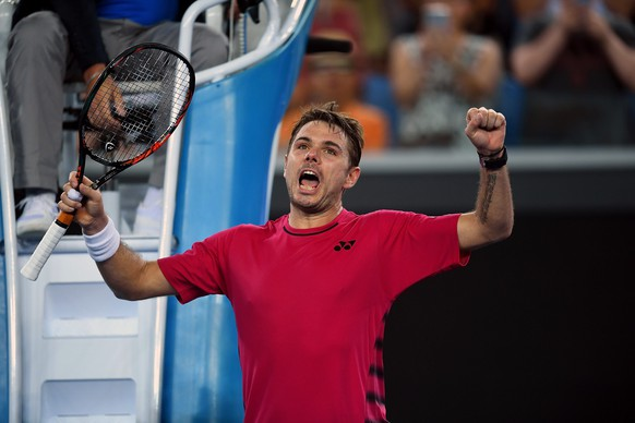 epa05721497 Stan Wawrinka of Switzerland celebrates his match win against Martin Klizan of Slovakia during their Men's Singles first round match of the Australian Open Grand Slam tennis tournament in Melbourne, Australia, 16 January 2017.  EPA/LUKAS COCH  AUSTRALIA AND NEW ZEALAND OUT