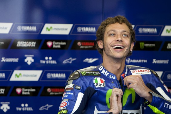 Yamaha MotoGP rider Valentino Rossi of Italy reacts in his pit box during a warm up session at the TT Assen Grand Prix at Assen, Netherlands June 27, 2015. REUTERS/Ronald Fleurbaaij