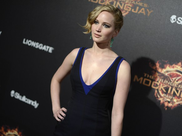Actress Jennifer Lawrence poses for photographers as she arrives at the Hunger Games: Mockingjay - Part 1 party at the 67th international film festival, Cannes, southern France, Saturday, May 17, 2014. (Photo by Arthur Mola/Invision/AP)