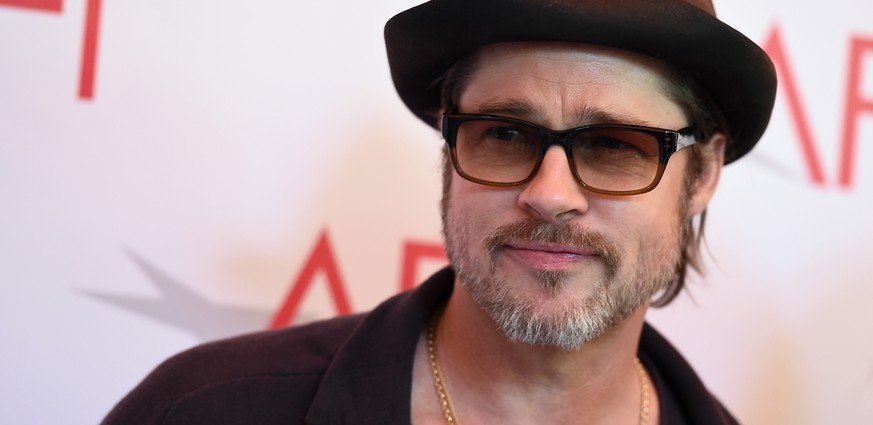 "FILE - In this Friday, Jan. 9, 2015, file photo, Brad Pitt arrives at the AFI Awards at The Four Seasons Hotel in Los Angeles. Netflix has acquired the satirical comedy ""War Machine,"" with Pitt set to star as General Stanley McChrystal. The acquisition, announced Monday, June 8, 2015, by Netflix, adds a major dose of star power to the streaming service's growing stable of original films. Netflix will produce the film, to be directed by Australian filmmaker David Michod. (Photo by Jordan Strauss/Invision/AP, File)"