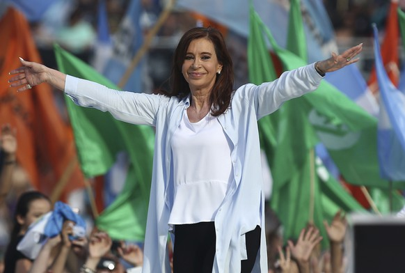 Argentina's former president who is running for senator, Cristina Fernandez de Kirchner, gestures to supporters during a campaign rally at Racing Club stadium in Buenos Aires, Argentina, Monday, Oct. 16, 2017. Fernandez, who returned to Argentina's political stage by launching a new party in late June, will compete for a senate seat in the midterm elections on Sunday, Oct. 22. (AP Photo/Agustin Marcarian)