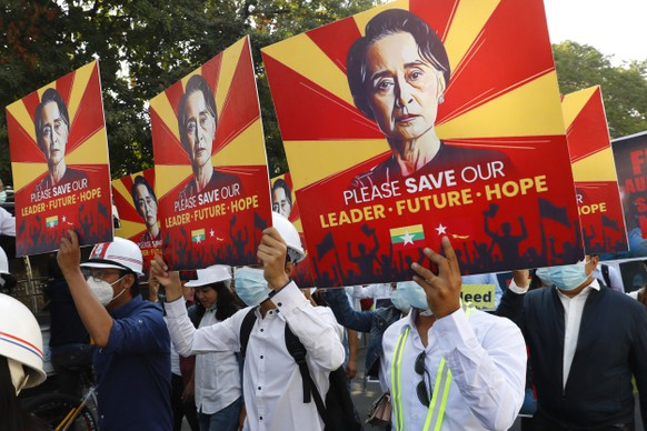Engineers hold posters with an image of deposed Myanmar leader Aung San Suu Kyi as they stage an anti-coup protest march in Mandalay, Myanmar, Monday, Feb. 15, 2021. The hopes of building a robust democracy in Myanmar were shattered when the powerful military toppled the elected government of Aung San Suu Kyi and her National League for Democracy party in the Feb. 1 coup. (AP Photo)