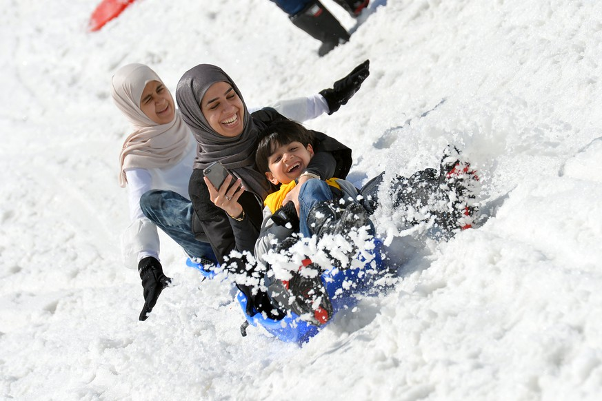 Tourists from Saudi Arabia enjoy a ride on a bob sled on the glacier of the Kitzsteinhorn mountain in Kaprun, in the Austrian province of Salzburg, Wednesday, June 10, 2015. This alpine area around Kaprun and Zell am See is a popular holiday destination for people from Saudi Arabia. For many of them it is the first contact with snow in their life. (AP Photo/ Kerstin Joensson)