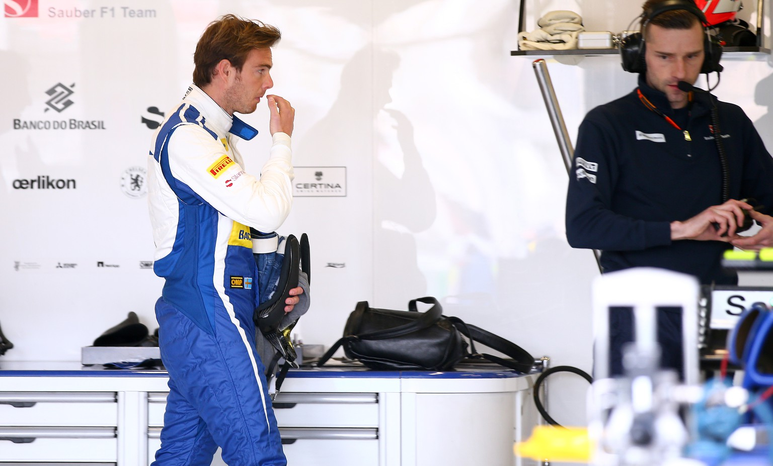 MELBOURNE, AUSTRALIA - MARCH 13:  Giedo van der Garde of Netherlands and Sauber F1 walks through the team garage during practice for the Australian Formula One Grand Prix at Albert Park on March 13, 2015 in Melbourne, Australia.  (Photo by Mark Thompson/Getty Images)