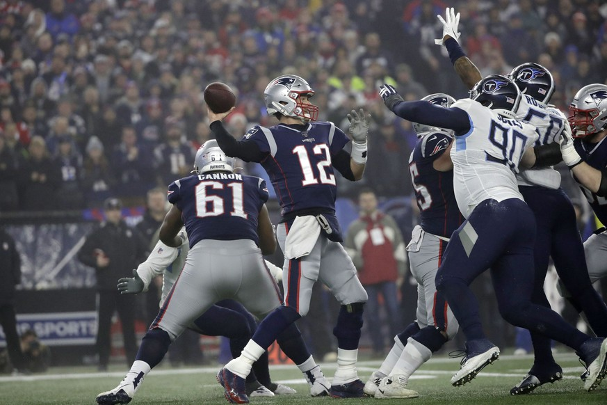 New England Patriots quarterback Tom Brady, center, passes under pressure from Tennessee Titans defensive end DaQuan Jones (90) and linebacker Derick Roberson (50) in the first half of an NFL wild-card playoff football game, Saturday, Jan. 4, 2020, in Foxborough, Mass. (AP Photo/Elise Amendola) Tom Brady,DaQuan Jones,Derick Roberson