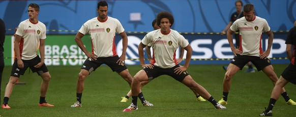 (From L) Belgium's midfielder Adnan Januzaj, Belgium's midfielder Nacer Chadli, Belgium's midfielder Axel Witsel and Belgium's defender Toby Alderweireld attend a team training session at Mane Garrincha National Stadium in Brasilila, some 1160 kilometers north-west of Rio de Janeiro on July 4, 2014, ahead of their 2014 FIFA World Cup Brazil quarter-final football match against Argentina on July 5.  AFP PHOTO / MARTIN BUREAU