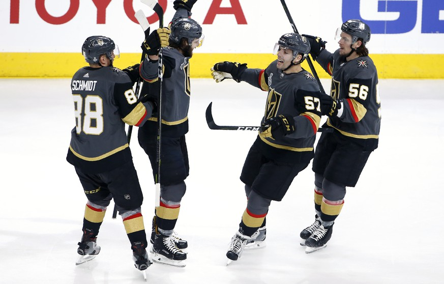 Vegas Golden Knights defenseman Colin Miller, second from left, celebrates his goal with defenseman Nate Schmidt, left, left wing David Perron, second from right, and left wing Erik Haula during first period in Game 1 of the NHL hockey Stanley Cup Finals against the Washington Capitals Monday, May 28, 2018, in Las Vegas. (AP Photo/Ross D. Franklin)
