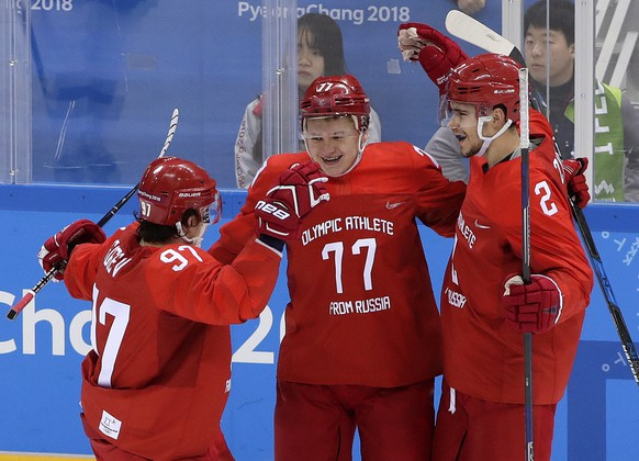 Russian athlete Kirill Kaprizov (77) celebrates with Nikita Gusev (97) and Artyom Zub (2) after scoring a goal during the third period of the preliminary round of the men's hockey game against Slovenia at the 2018 Winter Olympics in Gangneung, South Korea, Friday, Feb. 16, 2018. (AP Photo/Frank Franklin II)
