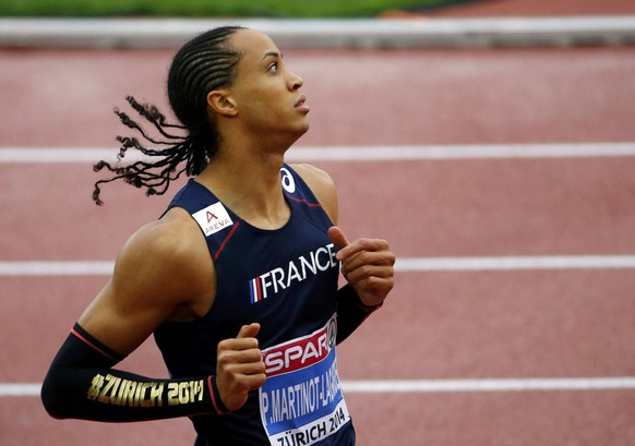 Pascal Martinot-Lagarde of France reacts after competing in the men's 110 metres hurdles heats during the European Athletics Championships at the Letzigrund Stadium in Zurich August 13, 2014. REUTERS/Arnd Wiegmann (SWITZERLAND  - Tags: SPORT ATHLETICS)