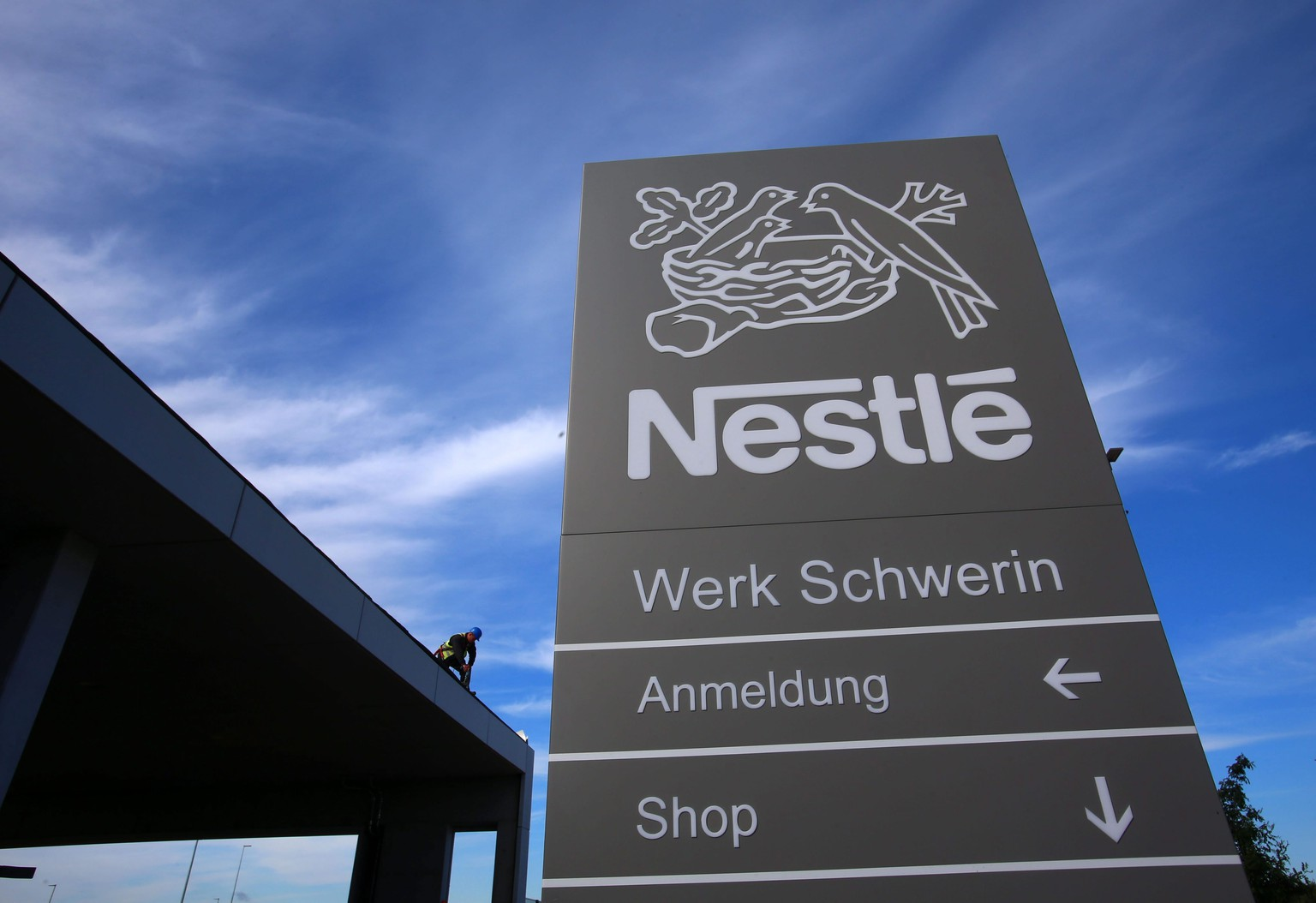 epa04380310 A picture made available on 02 September 2014, shows the logo of Nestle on a sign at the new coffee factory of food and beverage company Nestle in Schwerin, Germany, 27 August 2014. The new factory will be officially inaugurated on 05 September 2014.  EPA/JENS BUETTNER