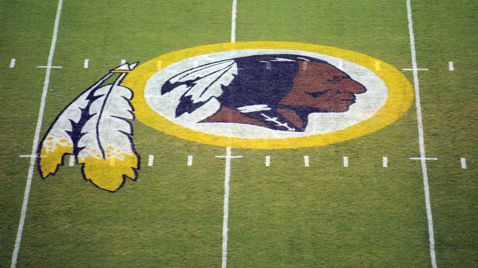 FILE - In this Aug. 28, 2009 file photo, the Washington Redskins logo is shown on the field before the start of a preseason NFL football game against the New England Patriots in Landover, Md. The Washington Redskins are undergoing what the team calls a
