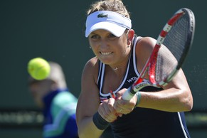 Timea Bacsinszky, of Switzerland, returns to Marina Erakovic, of New Zealand, during their match at the BNP Paribas Open tennis tournament, Friday, March 13, 2015, in Indian Wells, Calif. (AP Photo/Mark J. Terrill)