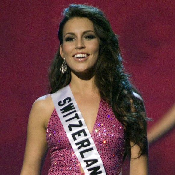 In this photo released by the Miss Universe 2008 organization, Miss Switzerland Amanda Ammann competes in a gown of her choice during the Evening Gown segment of the 2008 Miss Universe Presentation Show at the Crown Convention Center, in Nha Trang, Vietnam, on Tuesday, July 8, 2008. Ammann will compete in the 57th annual Miss Universe competition which will take place in Nha Trang, Vietnam at the Crown Convention Center on July 14, 2008 (KEYSTONE/AP Photo/ Miss Universe, Patrick Prather)