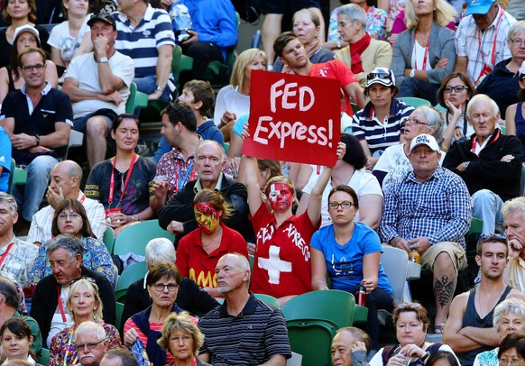 epa04035904 Swiss fans watch the quarter final match between Andy Murray of Britain and Roger Federer of Switzerland at the Australian Open Grand Slam tennis tournament in Melbourne, Australia, 22 January 2014.  EPA/DAVID CROSLING AUSTRALIA AND NEW ZEALAND OUT