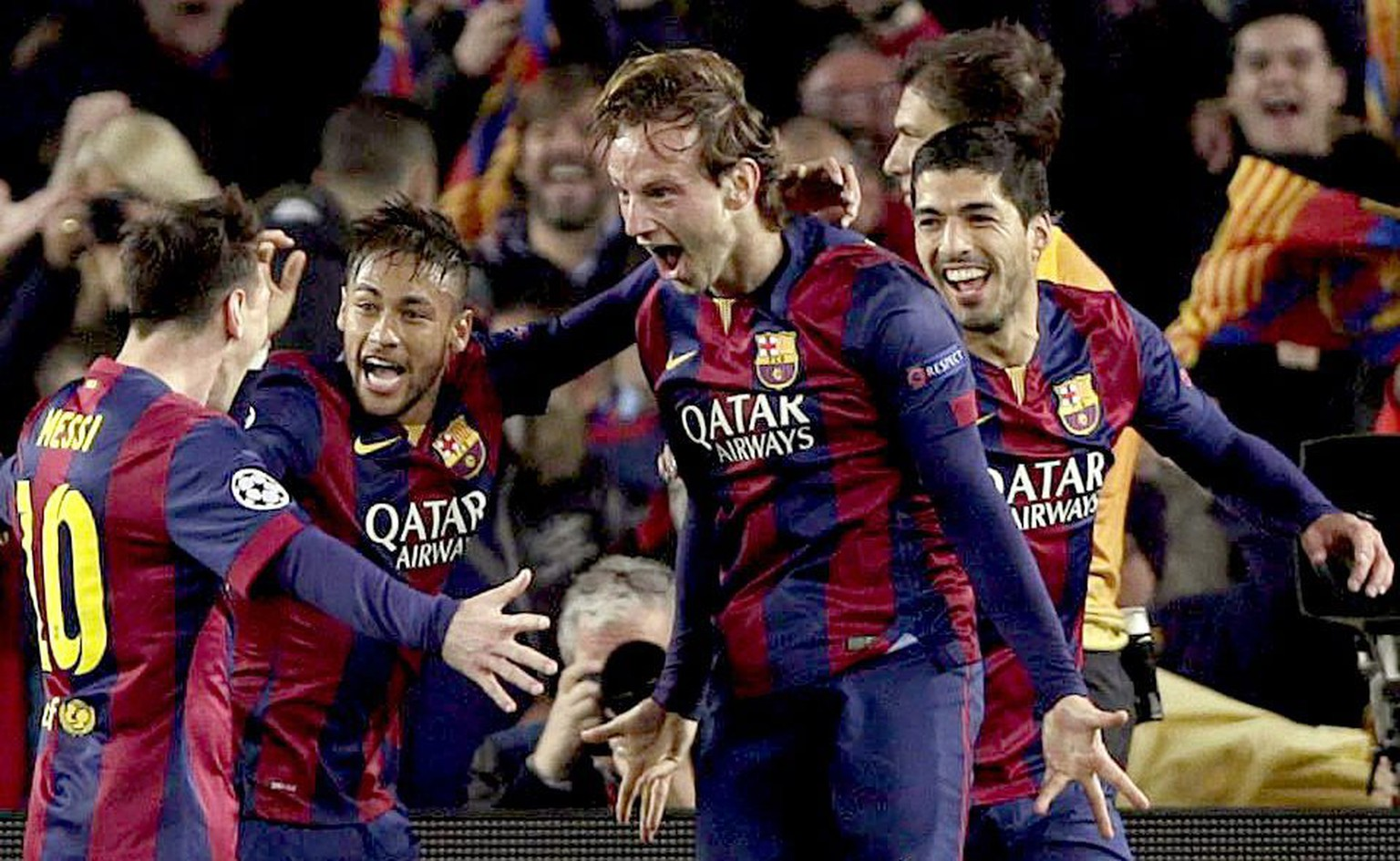 epa04668477 FC Barcelona's Croatian midfielder Ivan Rakitic (2-R) celebrates with Argentinian striker Lionel Messi (L), Brazilian Neymar Jr. (2-L) and Uruguayan Luis Suarez (R) after scoring the opening goal against Manchester City during the UEFA Champions League round of 16 seocnd leg match played at Camp Nou stadium, in Barcelona, Spain, 18 March 2015.  EPA/Alberto Estevez