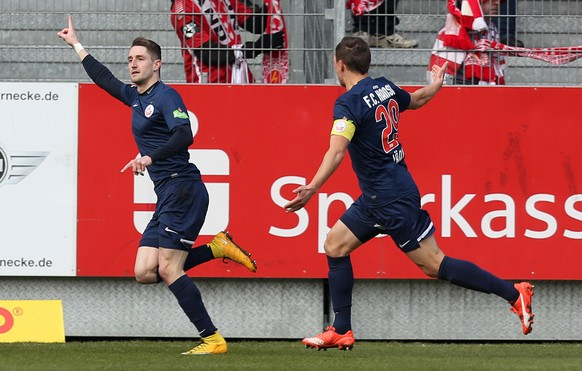 COTTBUS, GERMANY - FEBRUARY 27:  Stephan Andrist (L) of Rostock jubilates after scoring the first goal during the third league match between FC Energie Cottbus and FC Hansa Rostock at Stadion der Freundschaft on February 27, 2016 in Cottbus, Germany. (Photo by Matthias Kern/Bongarts/Getty Images)