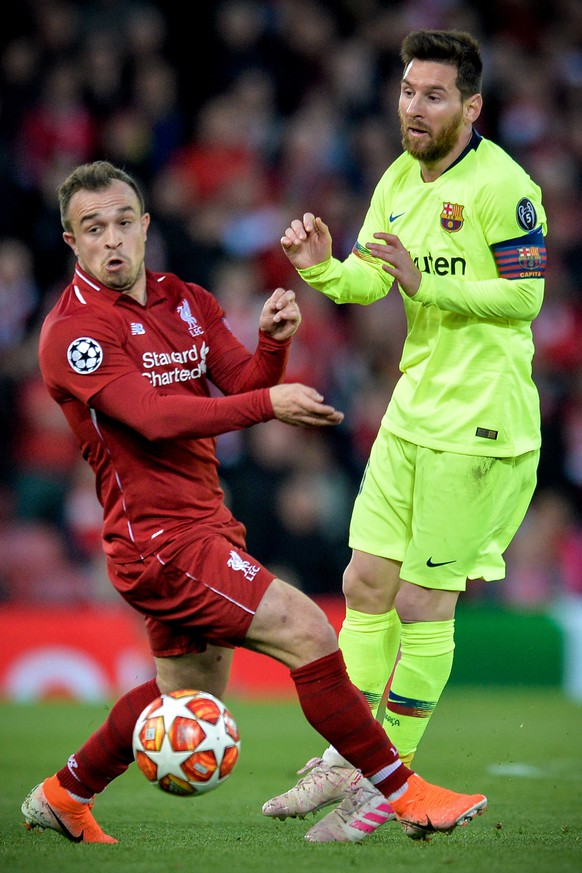 epa07554517 Liverpool's Xherdan Shaqiri (L) in action against Barcelona's Lionel Messi during the UEFA Champions League semi final second leg soccer match between Liverpool FC and FC Barcelona at Anfield stadium in Liverpool, Britain, 07 May 2019.  EPA/PETER POWELL