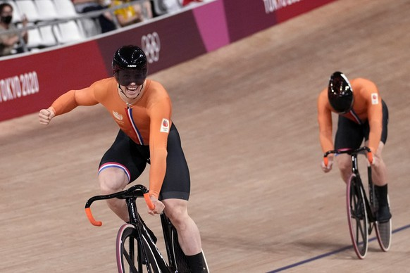 Harrie Lavreysen of Team Netherlands celebrates winning the gold medal over teammate Jeffrey Hoogland, behind, during the track cycling men's sprint race at the 2020 Summer Olympics, Friday, Aug. 6, 2021, in Izu, Japan. (AP Photo/Christophe Ena)