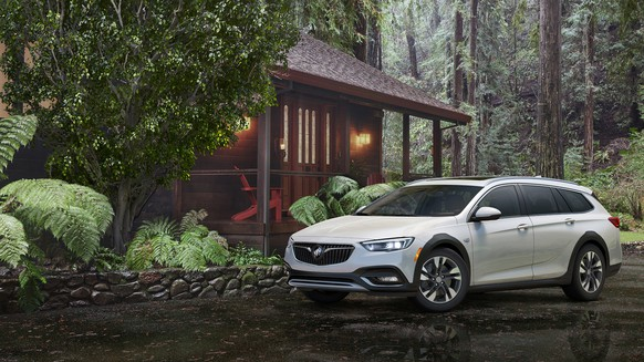 This photo provided by General Motors Company shows the 2018 Buick Regal Tour X. Under the hood, every Regal Tour X will be motivated by GM's familiar 2.0-liter turbocharged four-cylinder engine, rated at 250 horsepower and 295 pound-feet of torque in this application. In a nod to rugged rivals such as the Audi Allroad and Subaru Outback, all-wheel drive will come standard as will crossover-inspired plastic wheel arches and a little extra ground clearance. (Courtesy of General Motors Corporation via AP)