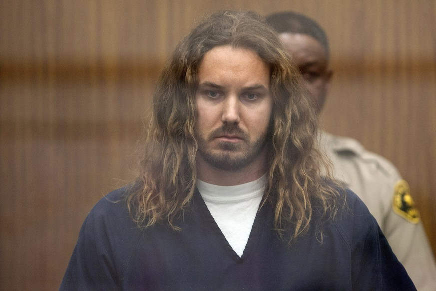 FILE - In this May 9, 2013 file pool photo, Tim Lambesis, singer for the Christian-inspired heavy metal group As I Lay Dying, appears in Vista Superior Court in Vista, Calif. Lambesis, convicted in a murder-for-hire plot to kill his estranged wife, was reunited with his Grammy-nominated band for the first time since May 2013 and performed with the group in San Diego over the weekend. Lambesis pleaded guilty in the case and served two years of a six-year sentence. (Bill Wechter/The San Diego Union-Tribune via AP)