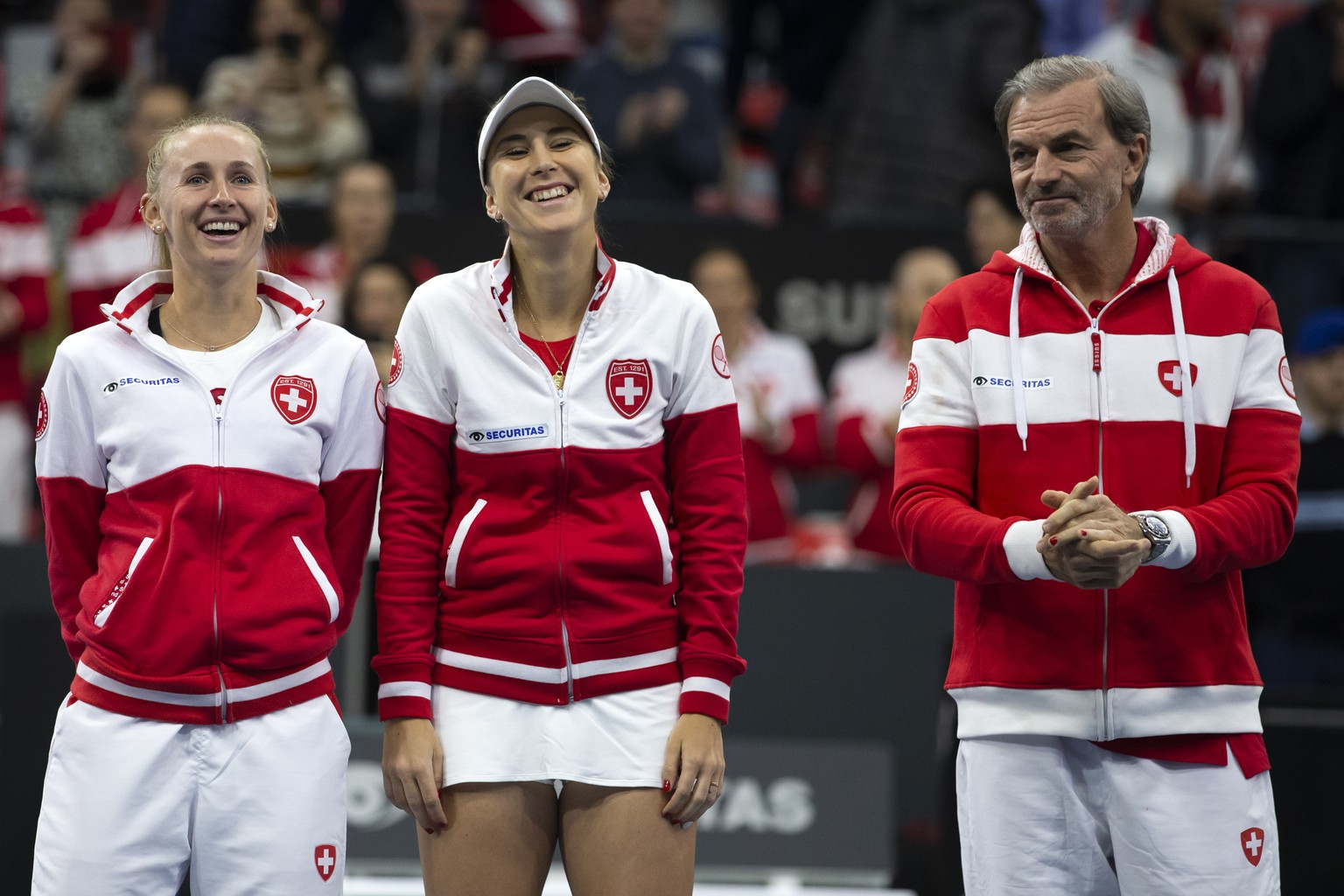 Switzerland's players Jil Teichmann, Belinda Bencic and team captain Heinz Guenthardt, from left, during the team presentation at the Fed Cup qualifier between Switzerland and Canada in the Swiss Tennis Arena in Biel, Switzerland, February 8, 2020.(KEYSTONE/Peter Klaunzer)