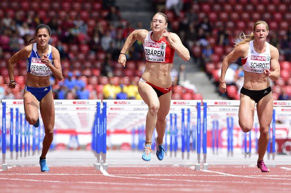 epa04350431 Noemi Zbaeren (C) from Switzerland, Elisavet Pesiridou (L) from Greece, and Beate Schrott (R) from Austria compete in the women's 100m Hurdles heat during the European Athletics Championships 2014 in the Letzigrund Stadium in Zurich, Switzerland, 12 August 2014.  EPA/STEFFEN SCHMIDT