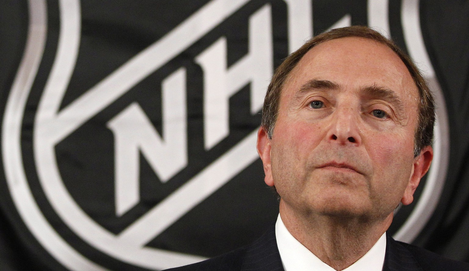 FILE - In this Sept. 13, 2012, file photo, NHL commissioner Gary Bettman listens as he meets with reporters after a meeting with team owners in New York. The National Hockey Leage Players' Association announces its decision whether to terminate the current collective bargaining agreement and set the clock ticking toward another potential work stoppage in 2020. (AP Photo/Mary Altaffer, File) Gary Bettman