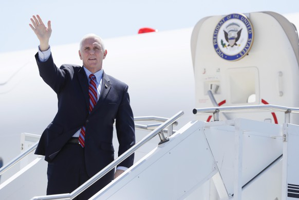 Vice President Mike Pence waves as he stops off Air Force Two after arriving at the Des Moines International Airport before meeting with faith leaders and food industry executives in response to the coronavirus pandemic, Friday, May 8, 2020, in Des Moines, Iowa. (AP Photo/Charlie Neibergall) Mike Pence
