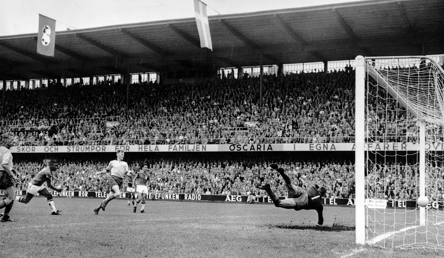 Seventeen-year-old Pele, second from left, scores Brazil's third goal in the World Cup soccer final against Sweden in Stockholm, June 29, 1958. At right, Sweden's goalkeeper Kalle Svensson makes a futile effort to make a save. Brazil won 5-2 to take the World Cup championship. (KEYSTONE/AP Photo)