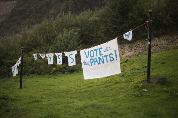 EDINBURGH, SCOTLAND - SEPTEMBER 18:  Underwear and laundry hang from a washing line below Edinburgh Castle supporting a Yes vote during the scottish referendum on September 18, 2014 in Edinburgh, Scotland. After many months of campaigning the people of Scotland today head to the polls to decide the fate of their country.  The referendum is too close to call but a Yes vote would see the break-up of the United Kingdom and Scotland would stand as an independent country for the first time since the formation of the Union.  (Photo by Christopher Furlong/Getty Images)