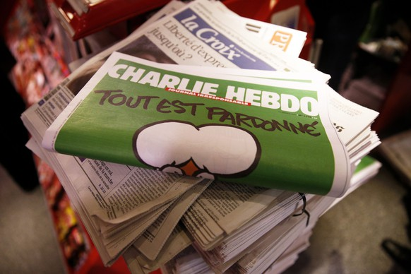 epa04599588 (FILE) A file picture dated 14 January 2015 of the 1179 edition of French satirical magazine Charlie Hebdo on sale at Gare de Lyon train station, in Paris, France. According to reports, Charlie Hebdo on 01 February 2015 announced that the post-attack issue no. 1179, which saw a record print run of seven million copies, would be the last for the time being. The surviving team members are resting after burying their colleagues, a spokesperson for Charlie Hebdo said. The decision was taken due to an extreme workload for the satirical magazine's editorial department. The magazine emphasises that taking a break from publishing the magazine shall not be seen as shying away from terror threats.  EPA/YOAN VALAT  EPA/YOAN VALAT *** Local Caption *** 51735883