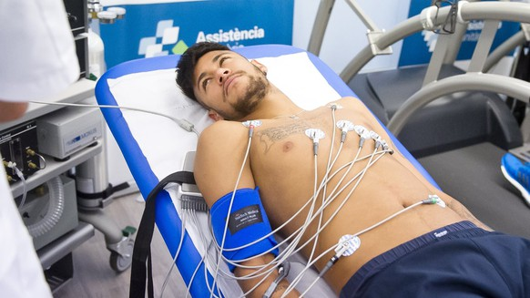 In this photo supplied by FC Barcelona,  Neymar from Brazil has a medical test in Barcelona, Spain, Wednesday Aug. 6, 2014. Neymar, who trained with their colleagues on Tuesday returned to the club for their medical tests. (AP Photo / F C Barcelona.cat)