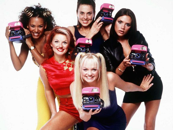 The Spice Girls, from left, Melanie Brown, Geri Halliwell, Melanie Chisholm, Emma Bunton, front, and Victoria Adams, pose with Polaroid cameras to concide with the Wednesday July 9 1997 launch of the new Polaroid SpiceCam. The camera, which is Polaroid's first to be named after a pop group, is scheduled to be unveiled in September, and the Spice Girls will appear in a series of commercials to promote it and a new line of instant films. (KEYSTONE/AP Photo/PA/HO/Str)