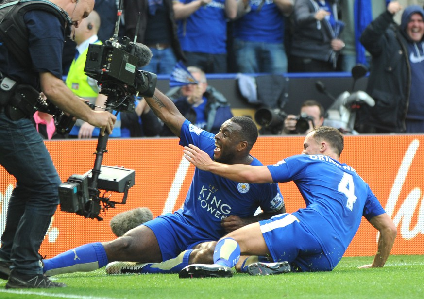 Leicester's Wes Morgan, left, celebrates after scoring with Leicester's Daniel Drinkwater during the English Premier League soccer match between Leicester City and Southampton at the King Power Stadium in Leicester, England, Sunday, April 3, 2016. (AP Photo/Rui Vieira)